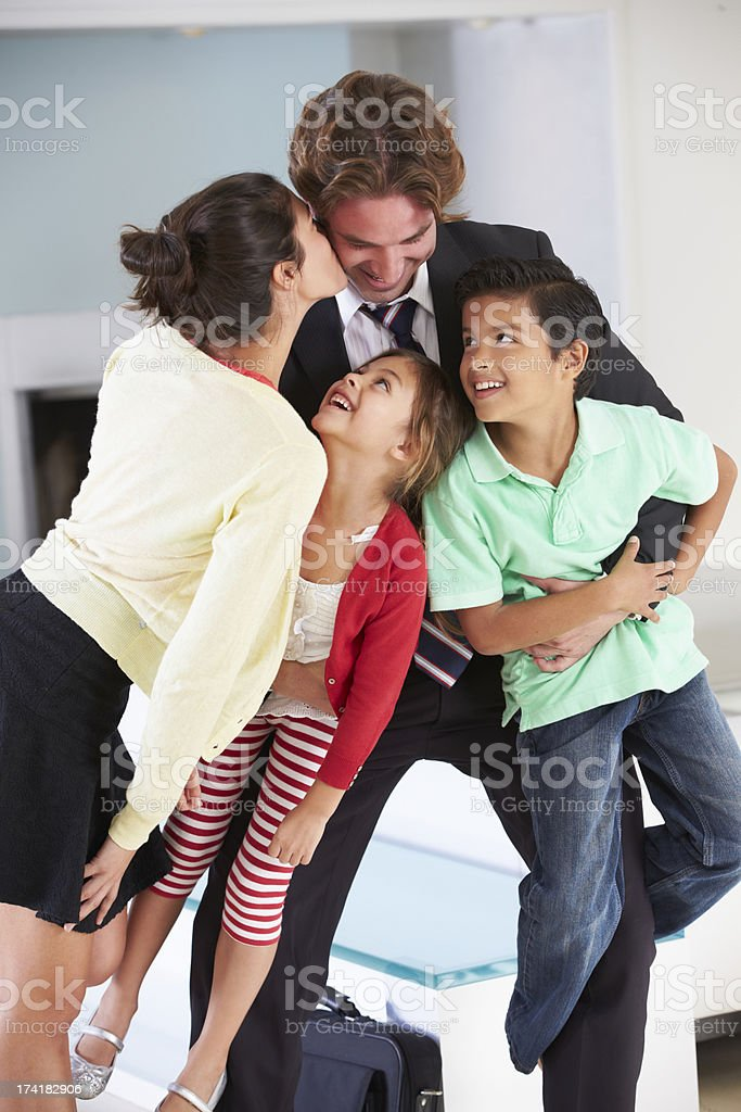 Family Greeting Father On Return From Work royalty-free stock photo