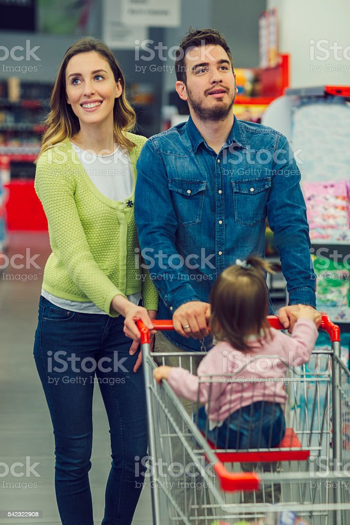 Family Groceries Shopping In Local Supermarket. stock photo