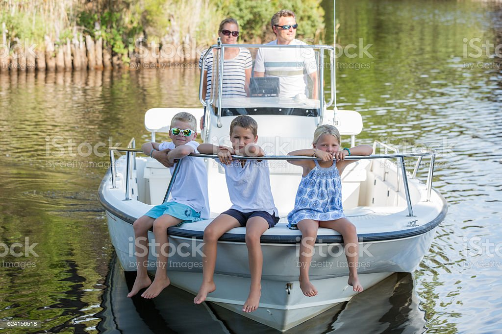 family hanging out together in a boat stock photo