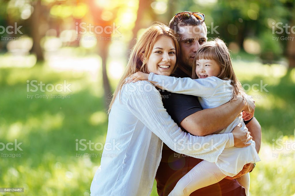Family happy outdoors with adopted child stock photo