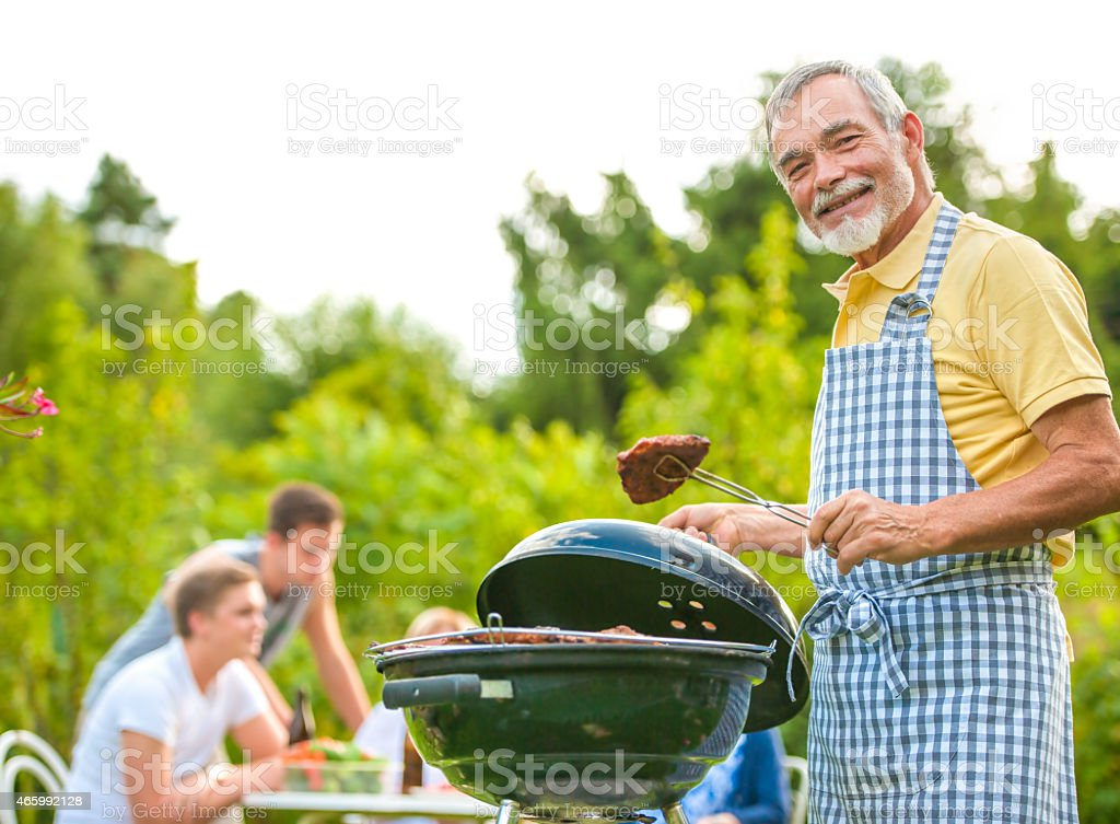 Family having a barbecue party stock photo