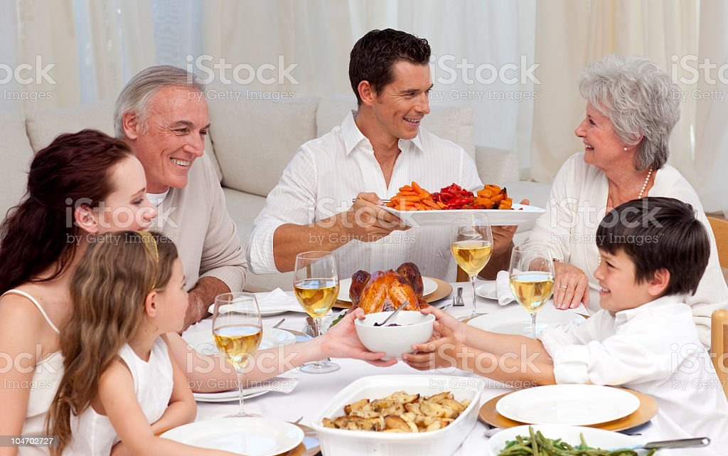 Family having a big dinner royalty-free stock photo