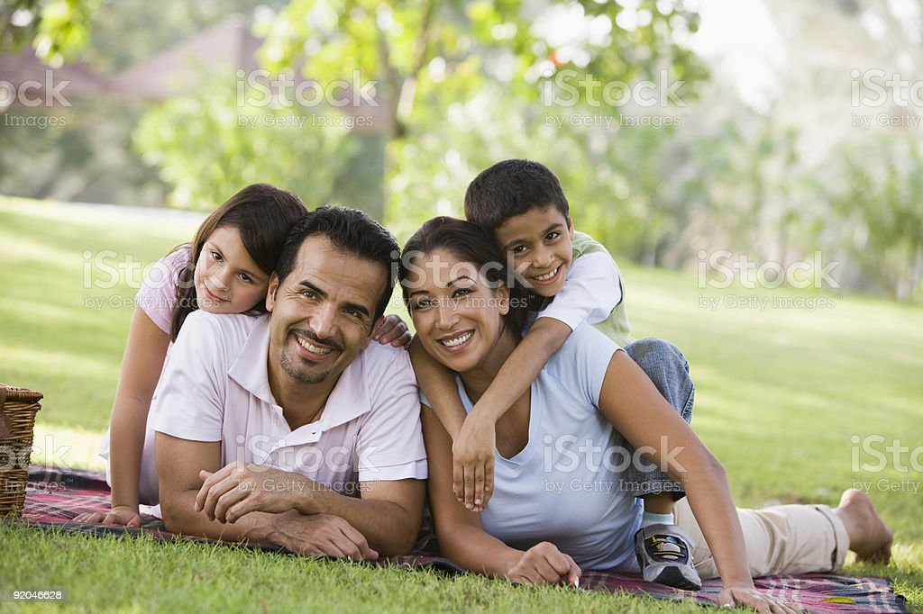 A family having a picnic in the park stock photo