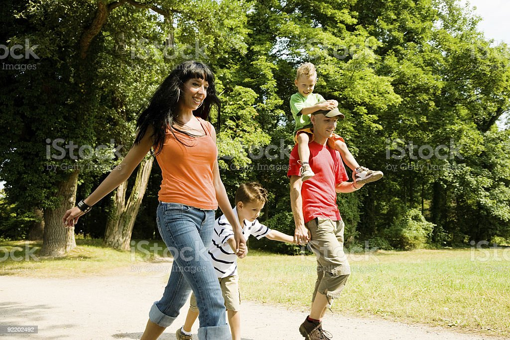 Family having a walk royalty-free stock photo