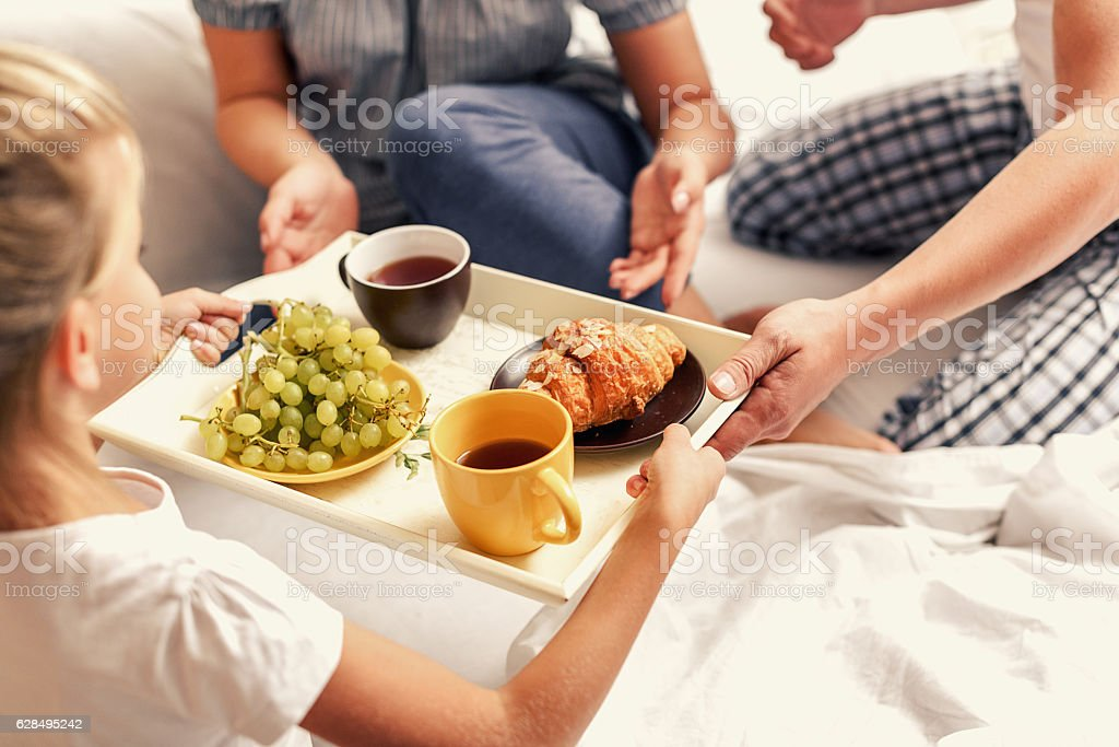 Family having breakfast at home stock photo