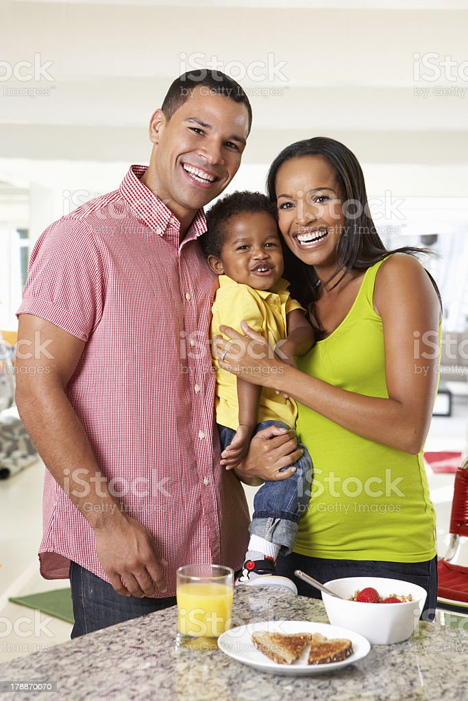 Family Having Breakfast In Kitchen Together royalty-free stock photo