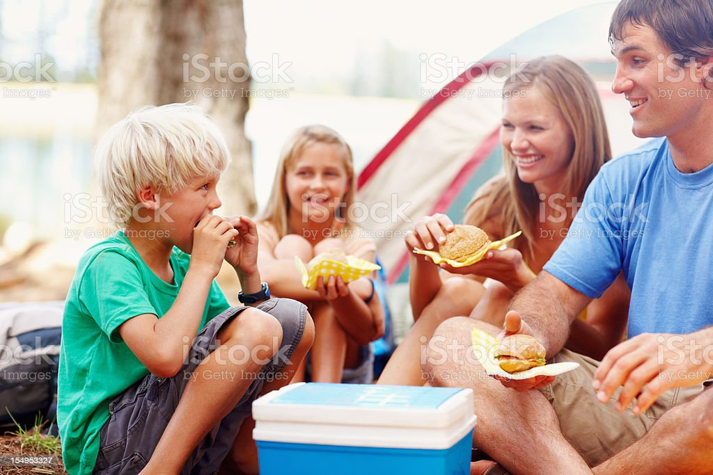 Family having breakfast while camping royalty-free stock photo