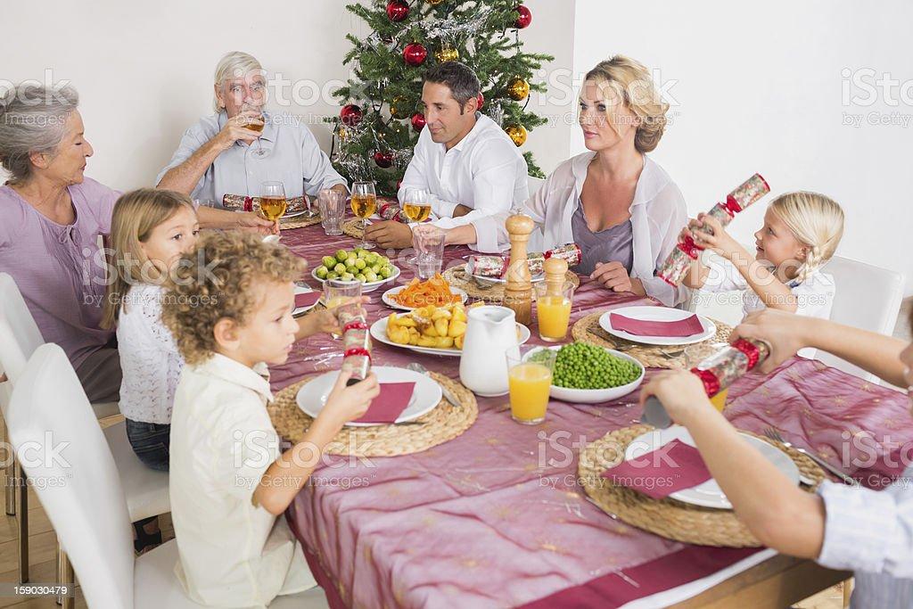 Family having christmas dinner royalty-free stock photo