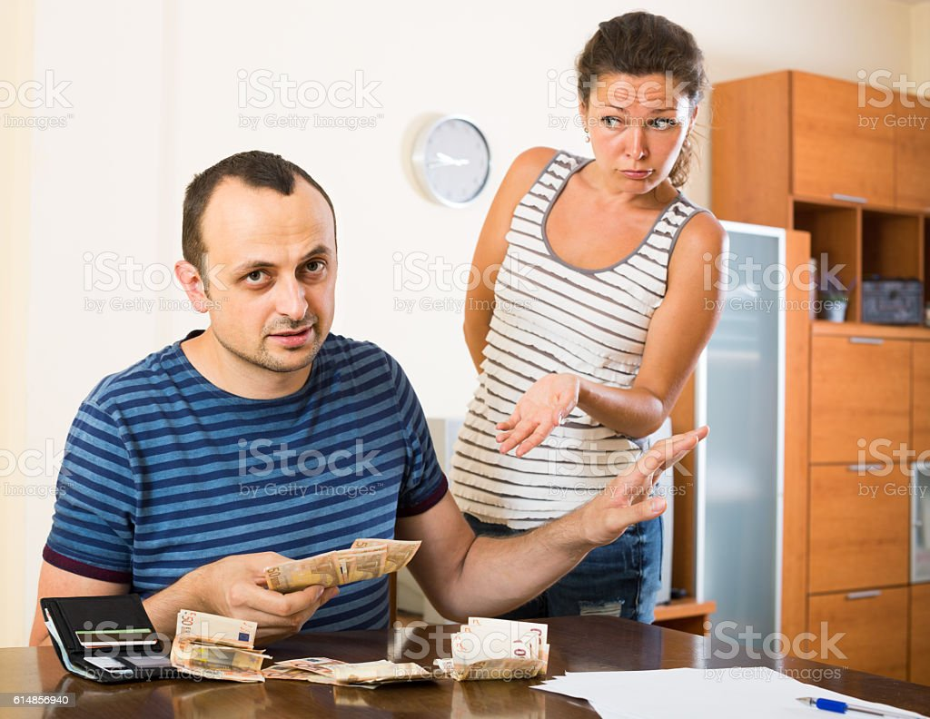 family having finacial problems and debts stock photo