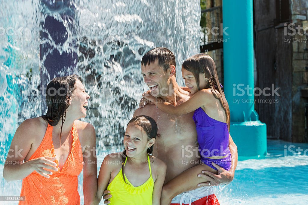 Family having fun at a water park stock photo
