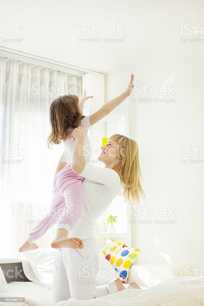 Family Having Fun in Bed. royalty-free stock photo