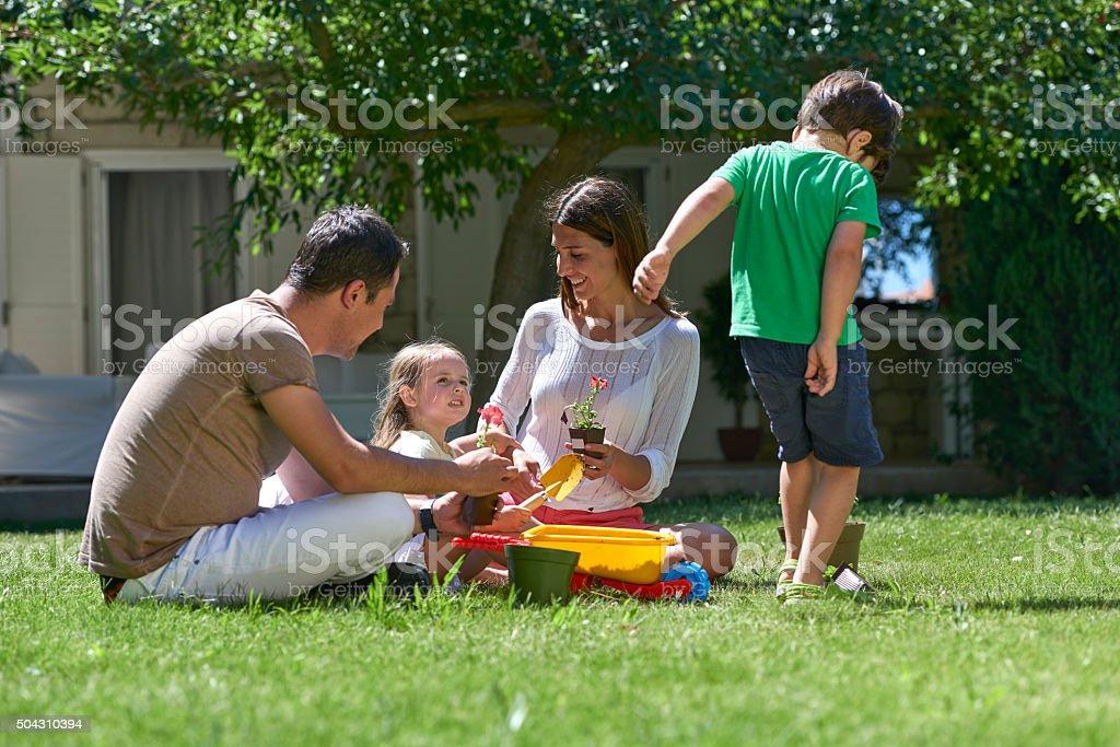 Family having fun in garden stock photo