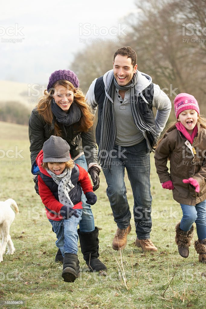 Family having fun in the country during winter royalty-free stock photo