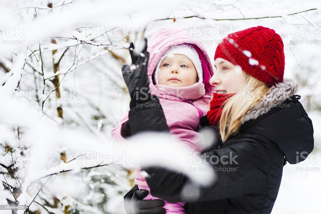 Family having fun in winter royalty-free stock photo