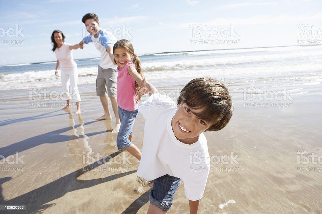 Family Having Fun On Beach Holiday stock photo