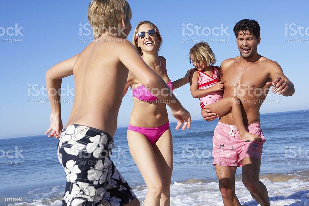 Family Having Fun On Beach royalty-free stock photo
