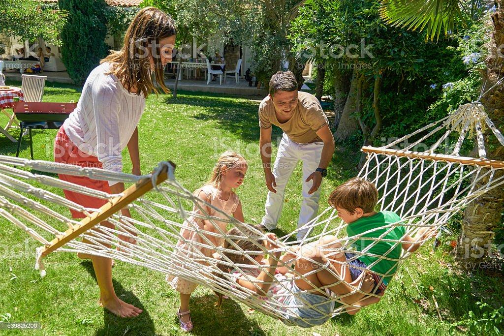 Family having fun on hammock stock photo