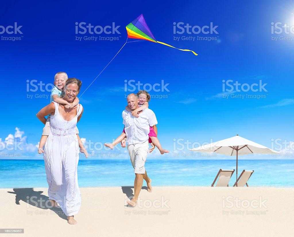 Family having fun on the beach royalty-free stock photo