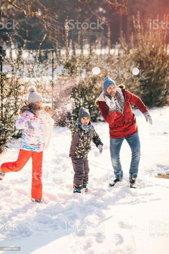 Family Having Fun Outdoors At Winter stock photo