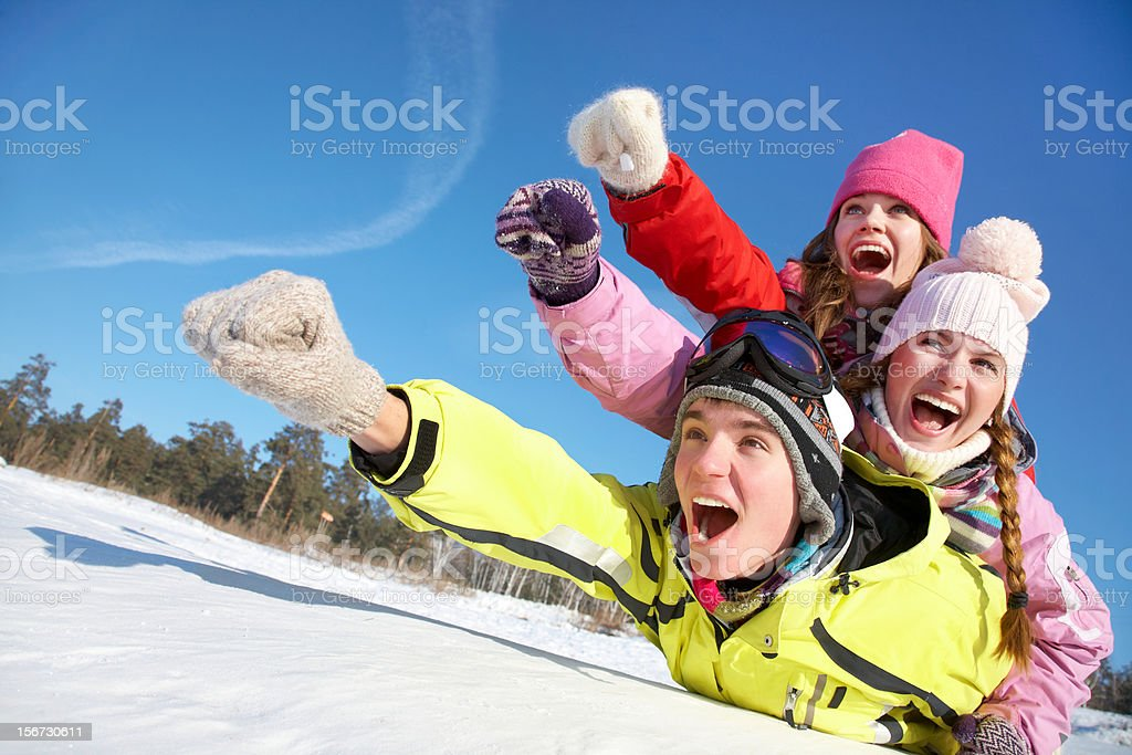 A family having fun outdoors in the wintertime stock photo