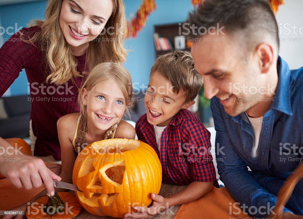 Family having fun together during halloween stock photo