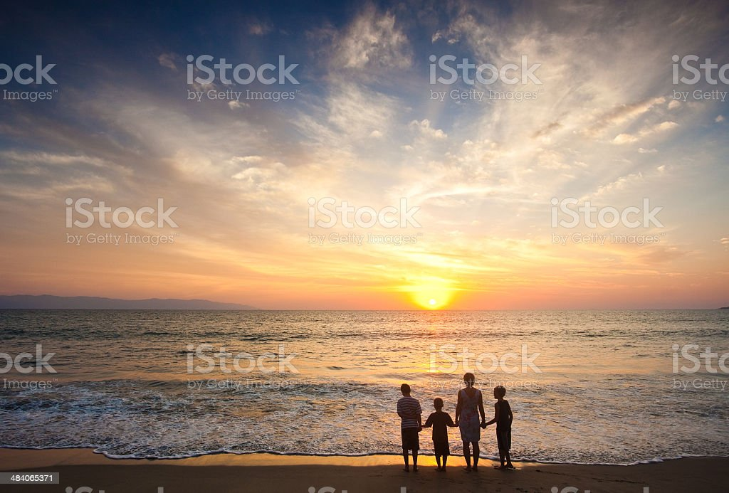 Family Having Fun Together on a Tropical Beach stock photo