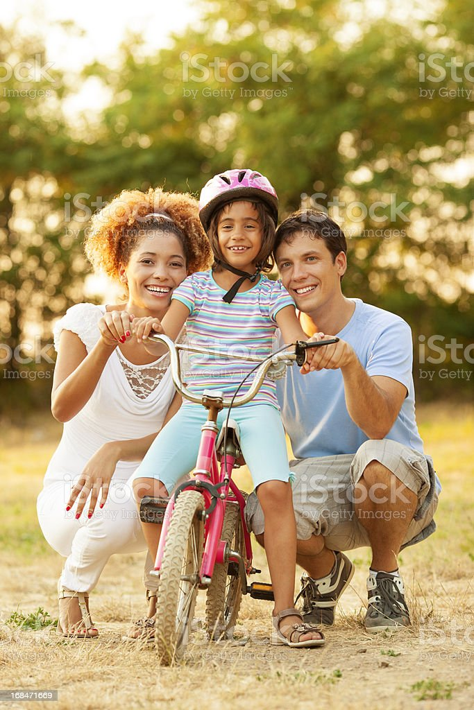 Family Having Fun With Bike Outdoors. royalty-free stock photo