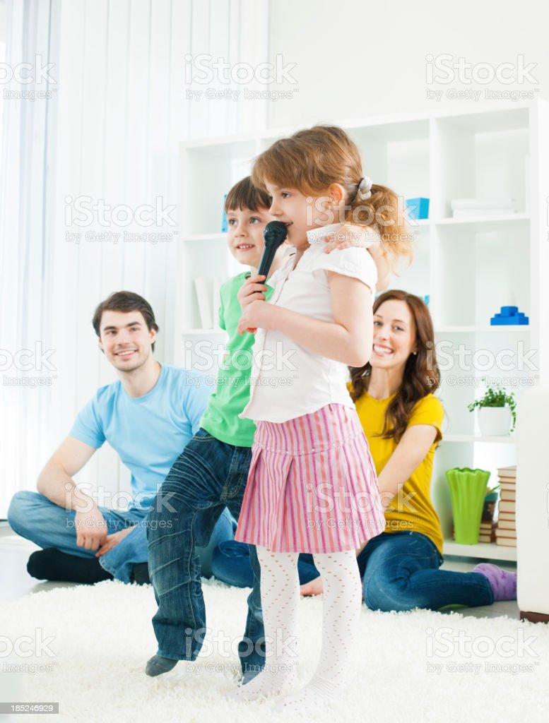 Family Having fun with karaoke stock photo