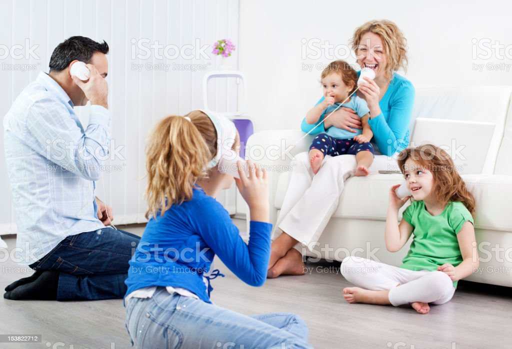 Family having fun with string phones. royalty-free stock photo