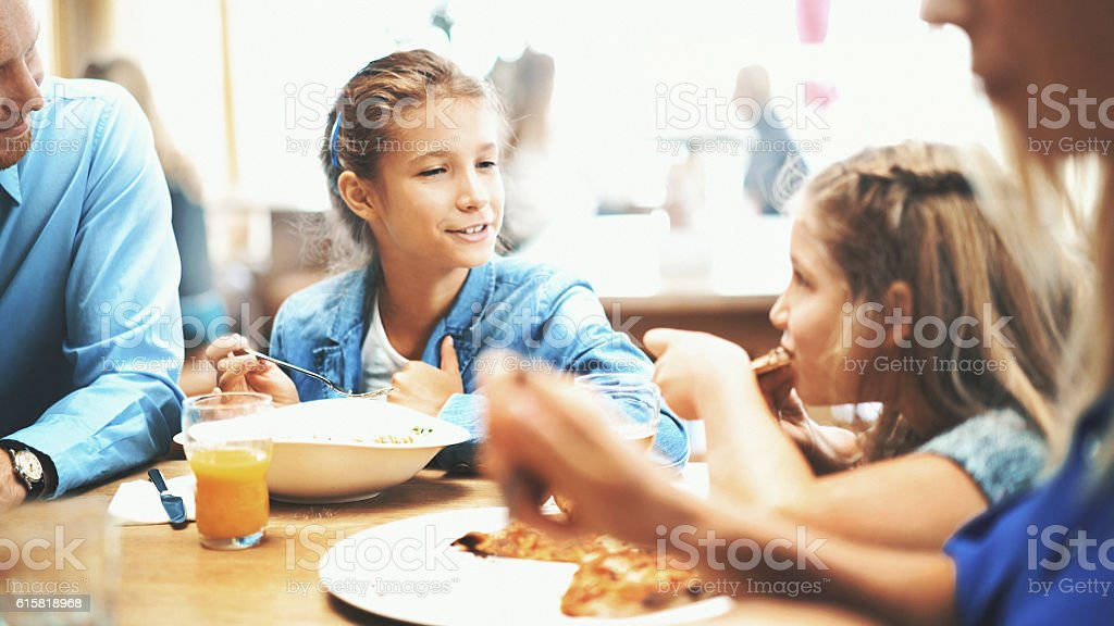 Family having lunch in a restaurant. stock photo