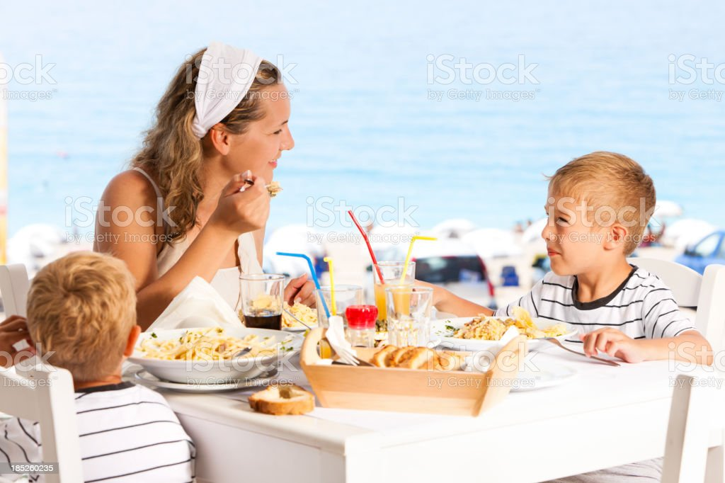 Family having lunch in the restaurant stock photo