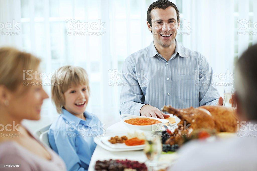 Family having Thanksgiving dinner. royalty-free stock photo