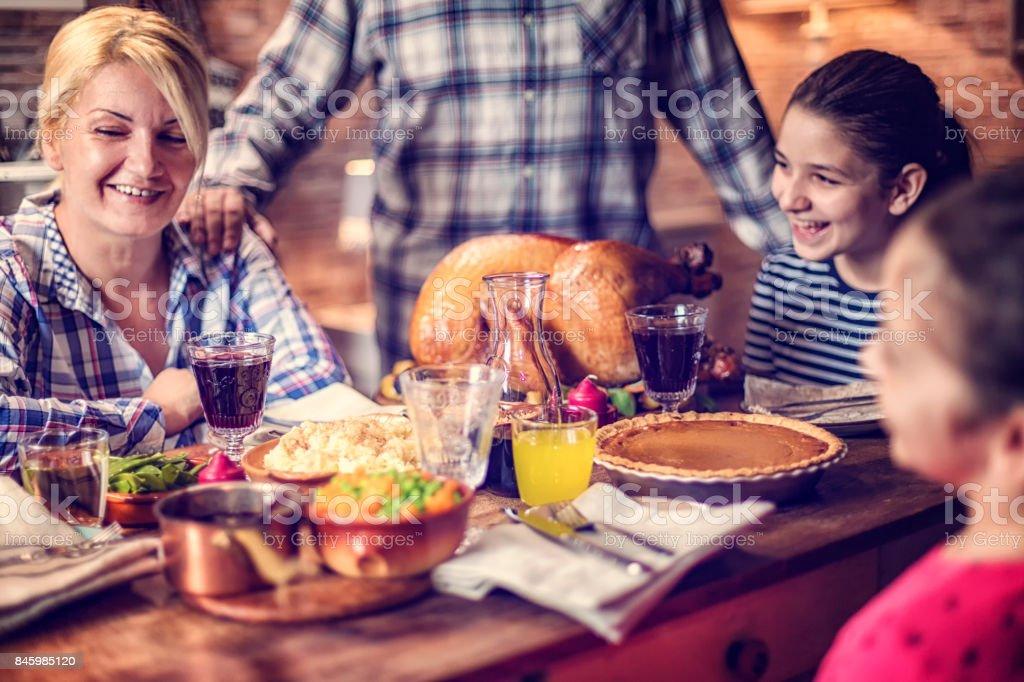 Family Having Traditional Holiday Stuffed Turkey Dinner stock photo