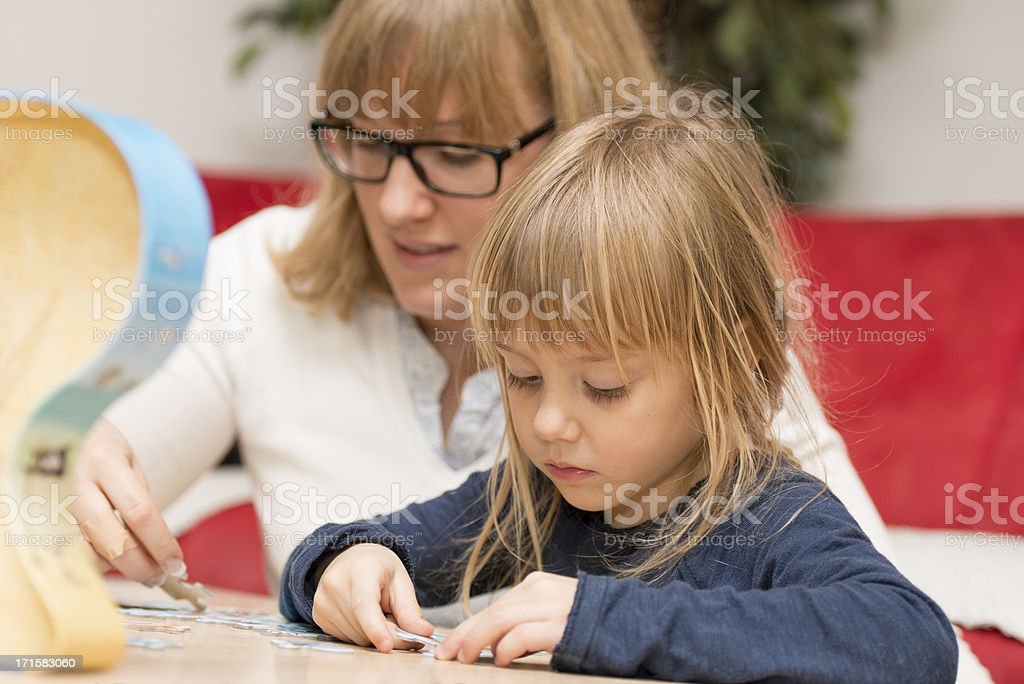 family helps gain knowledge for children royalty-free stock photo