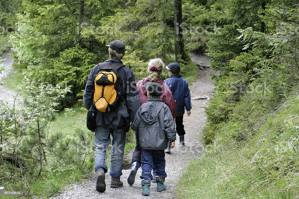 Family Hike on wooded path royalty-free stock photo