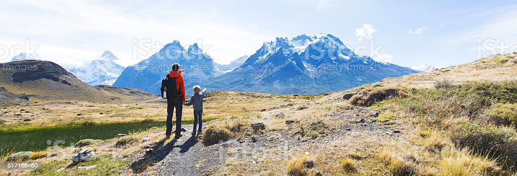 family hiking in patagonia stock photo