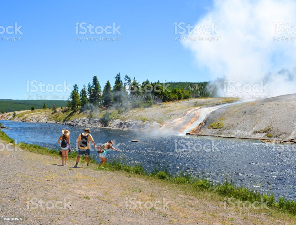 Family hiking on summer vacation. stock photo