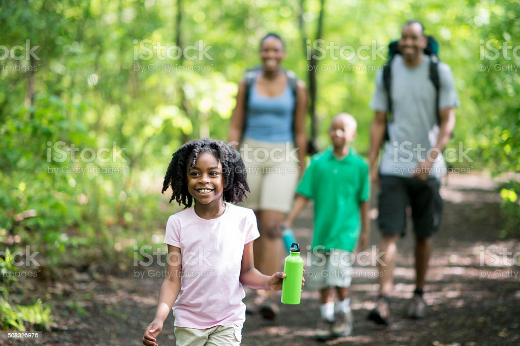 Family Hiking Through the Woods stock photo