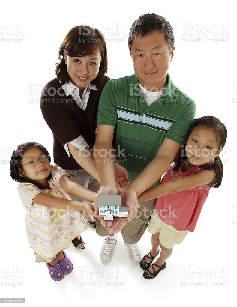 Family Holding a Home in Their Hands stock photo