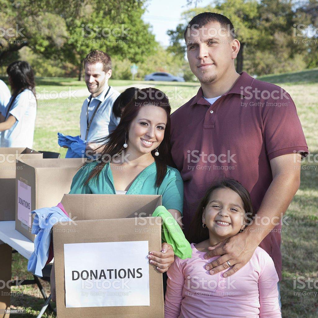 Family holding donations box at a donation center royalty-free stock photo
