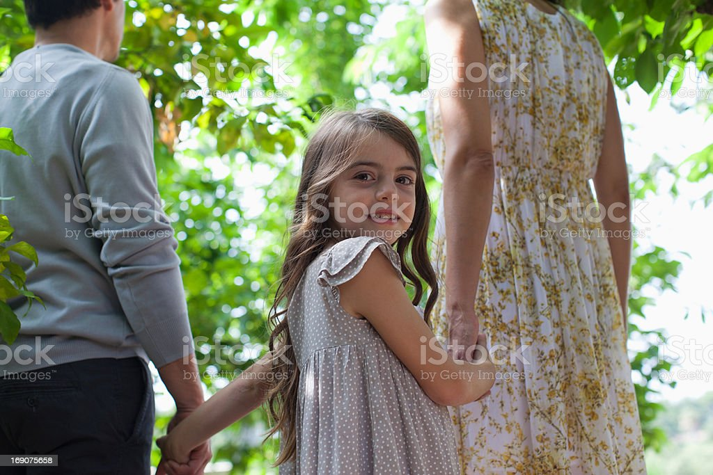 Family holding hands together outdoors stock photo
