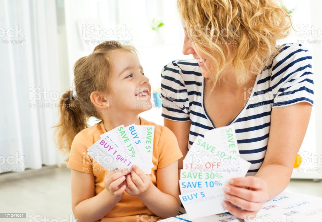 Family Holding shopping coupons. stock photo