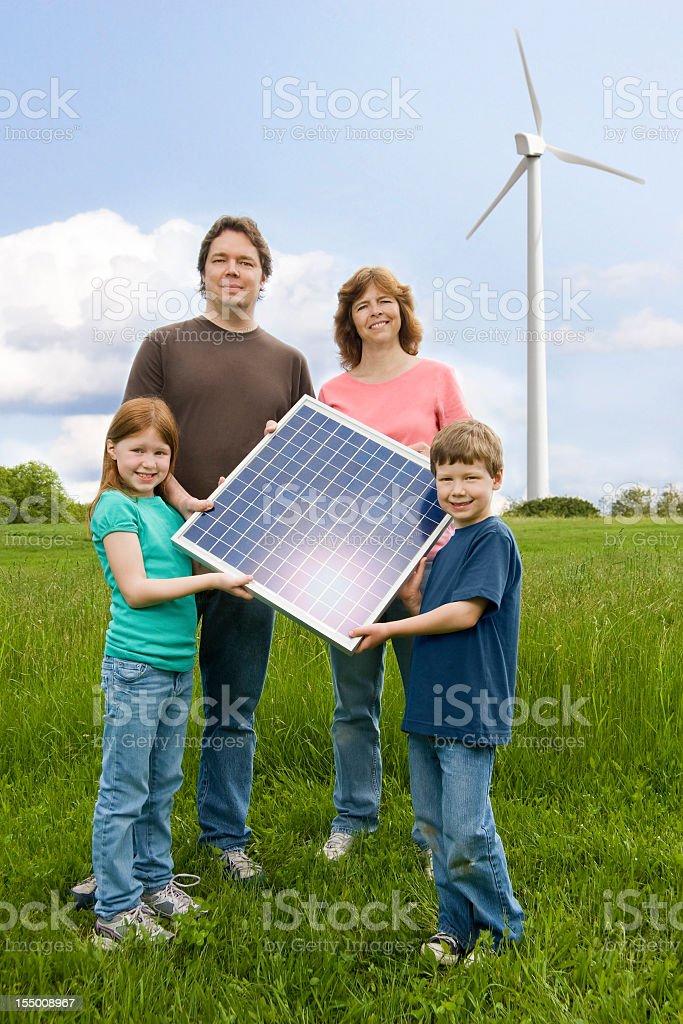 Family holding Solar Panel royalty-free stock photo