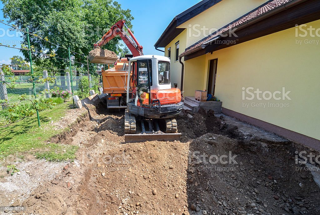 Family house is being rebuilt with an excavator stock photo