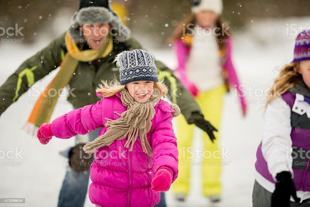 Family Ice Skating Outdoors stock photo