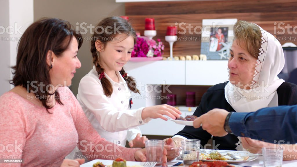 Family iftar meal in Ramadan stock photo