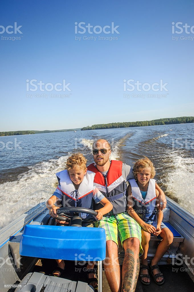 family in a boat stock photo