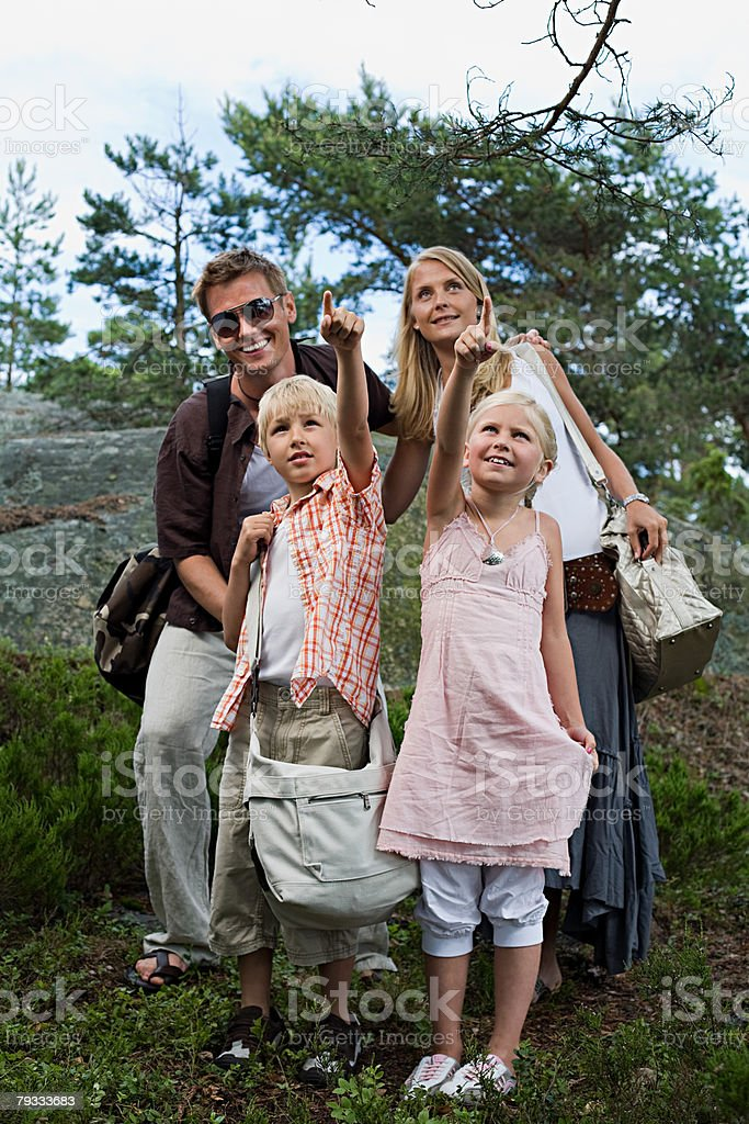 A family in a forest royalty-free stock photo