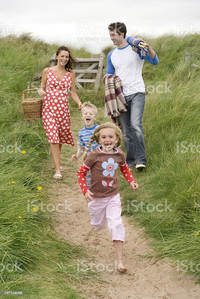 Family In A Hurry To The Beach For A Picnic royalty-free stock photo