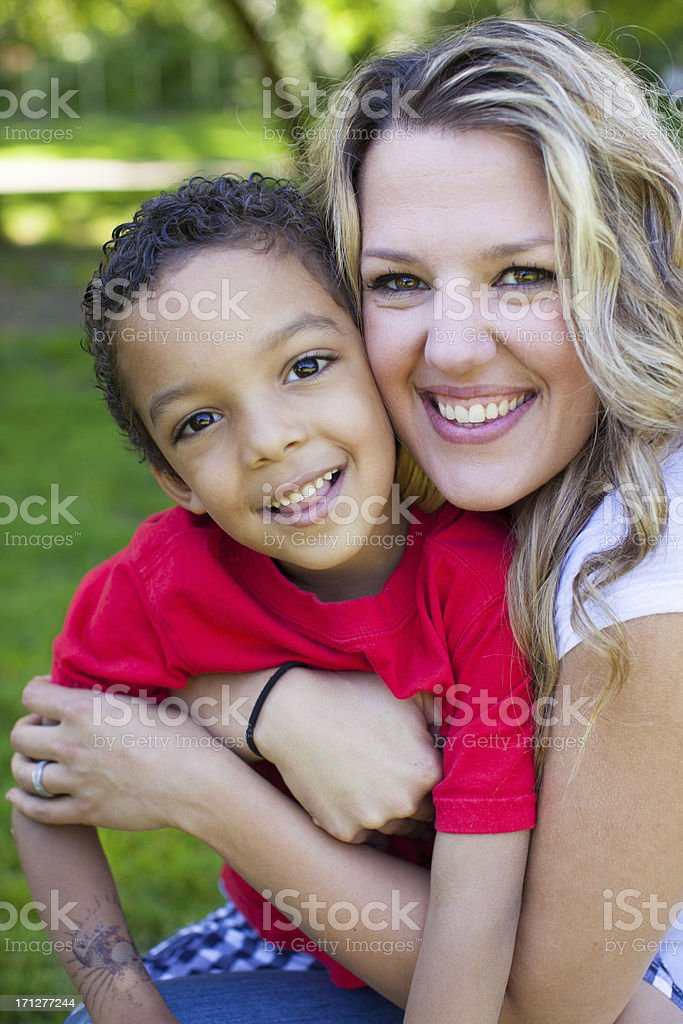 Family in a park enjoying the outdoors. stock photo